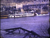 The signifiance of this photo is that it shows the W. P. SNYDER passing under the new Elizabeth Bridge just as the final pieces of the old Elizabeth Bridge had been dropped into the river by a welders cutting tool.  Photo from collection of Historic Elizabeth.
